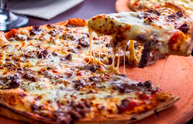 Cupom de desconto - 32% OFF em Pizza Gigante ou Calzone